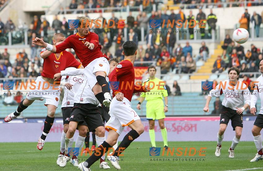 Philippe Mexes segna il secondo gol della Roma<br /> Philippe Mexes scores second Roma goal<br /> Italian &quot;Serie A&quot; 2006-07<br /> 25 Feb 2007 (Match Day 25)<br /> Roma-Reggina (3-0)<br /> &quot;Olimpico&quot;-Stadium-Roma-Italy<br /> Photographer: Andrea Staccioli INSIDE