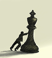 Man struggling to topple king chess piece