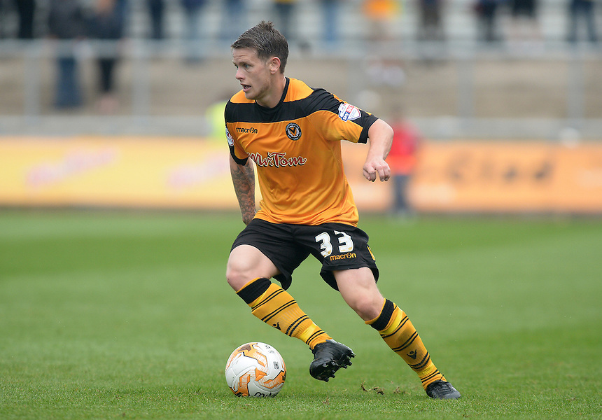 Newport County's Mark Byrne in action during todays match  <br /> <br /> Photographer Ian Cook/CameraSport<br /> <br /> Football - Newport County v Wycombe Wanderers - Sky Bet League 2 - Saturday 09th August 2014 - Rodney Parade - Newport<br /> <br /> &copy; CameraSport - 43 Linden Ave. Countesthorpe. Leicester. England. LE8 5PG - Tel: +44 (0) 116 277 4147 - admin@camerasport.com - www.camerasport.com