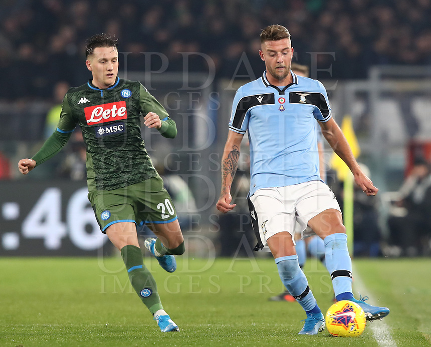 Football, Serie A: S.S. Lazio - Napoli, Olympic stadium, Rome, January 11, 2020.<br /> Lazio's Sergej Milinkovic-Savic (r) in action with Napoli's Piotr Zielinski (l) during the Italian Serie A football match between S.S. Lazio and Napoli at Rome's Olympic stadium, Rome , on January 11, 2020.<br /> UPDATE IMAGES PRESS/Isabella Bonotto