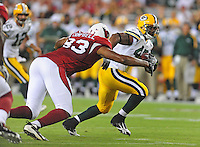 Aug. 28, 2009; Glendale, AZ, USA; Green Bay Packers running back (42) DeShawn Wynn is pursued by Arizona Cardinals defensive end (93) Calais Campbell during a preseason game at University of Phoenix Stadium. Mandatory Credit: Mark J. Rebilas-