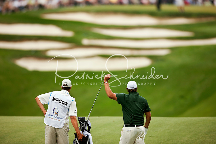 Caddie Jim McCay with golfer Phil Mickelson play the course during the Quail Hollow Championship golf tournament 2009. The event, formerly called the Wachovia Championship, is a top event on the PGA Tour, attracting such popular golf icons as Tiger Woods, Vijay Singh and Bubba Watson. Photo from the first round in the Quail Hollow Championship golf tournament at the Quail Hollow Club in Charlotte, N.C., Thursday, April 30, 2009.