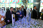 Egyptian Presidency shows  Egyptian President Abdel-Fattah el-Sissi and Sheikh Mohammed Bin Rashid al-Maktoum, ruler of Dubai look at a model of a planned new capital for Egypt display at Egypt Economic Development Conference (EEDC) in Sharm el-Sheikh, in the South Sinai governorate, south of Cairo, March 14, 2015. Gulf Arab allies pledged a further $12 billion of investments and central bank deposits for Egypt at an international summit on Friday, a big boost to President Abdel Fattah al-Sisi as he tries to reform the economy after years of political upheaval. . Photo by Egyptian Presidency