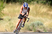 A triathlete leans into a corner during the Chelanman national qualifying triathlon in Lake Chelan in July, 2007