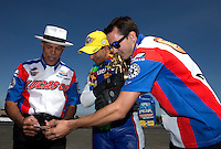 Jul. 28, 2013; Sonoma, CA, USA: NHRA pro stock motorcycle rider Hector Arana Jr (center) celebrates with father Hector Arana Sr (left) and Adam Arana after winning the Sonoma Nationals at Sonoma Raceway. Mandatory Credit: Mark J. Rebilas-