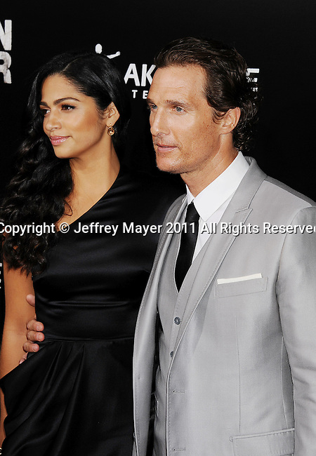 """HOLLYWOOD, CA - MARCH 10: Matthew McConaughey and Camila Alves arrive at the """"The Lincoln Lawyer"""" Los Angeles Screening at ArcLight Cinemas on March 10, 2011 in Hollywood, California."""