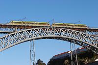 Dom Luis I bridge seen from Cais da Ribeira tram porto portugal