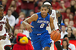 Guard Aaron Harrison of the Kentucky Wildcats drives down the court during the game against  the Louisville Cardinals at KFC Yum! Center on Saturday, December 27, 2014 in Louisville `, Ky. Kentucky defeated Louisville 58-50. Photo by Michael Reaves | Staff