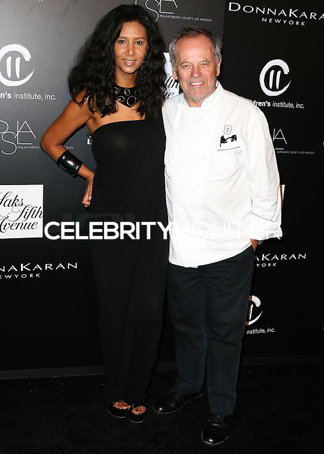 CULVER CITY, CA, USA - OCTOBER 08: Wolfgang Puck, Gelila Assefa arrive at the 5th Annual PSLA Autumn Party benefiting Children's Institute, Inc. held at 3Labs on October 8, 2014 in Culver City, California, United States. (Photo by Xavier Collin/Celebrity Monitor)