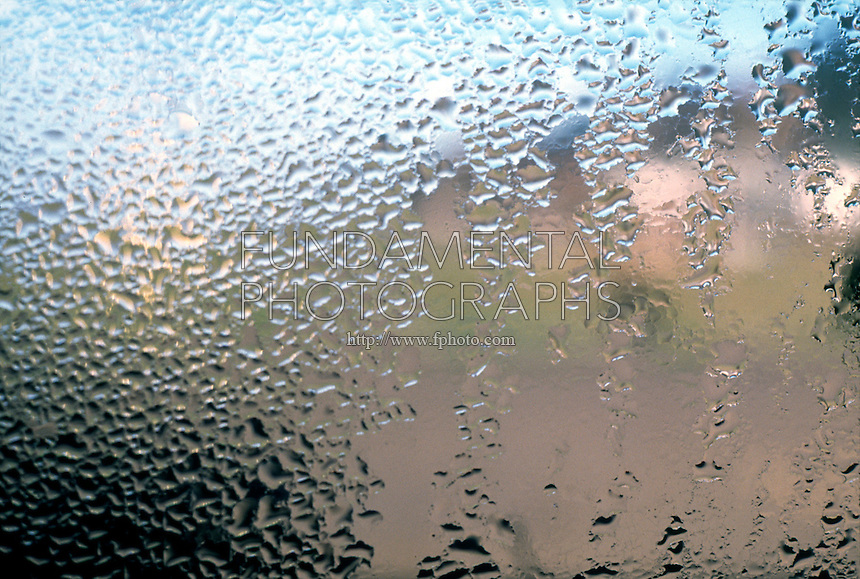 CONDENSATION OF WATER ON WINDOWPANE<br /> Water Vapor Changes To Droplets When Air Cools.