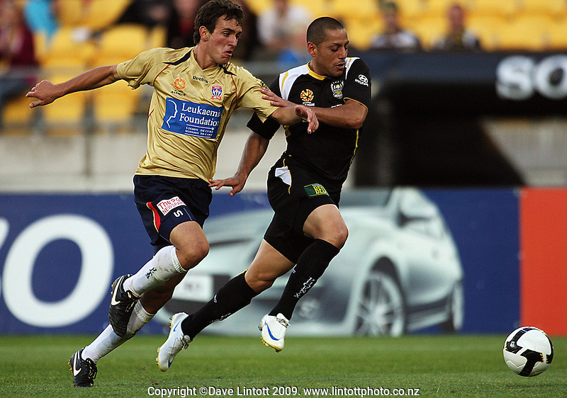 Benjamin Kantarovski and Leo Bertos chase the ball during the A-League match between Wellington Phoenix and Newcastle Jets at Westpac Stadium, Wellington, New Zealand on Sunday, 4 January 2009. Photo: Dave Lintott / lintottphoto.co.nz