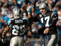 Carolina Panthers quarterback Jake Delhomme (17) high fives wide receiver Steve Smith (89) during an NFL football game at Bank of America Stadium in Charlotte, NC.