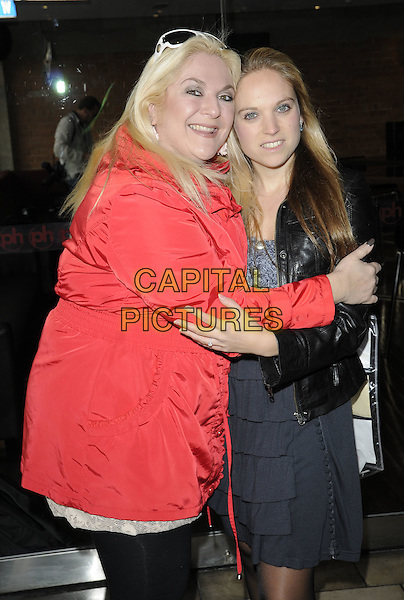 VANESSA FELTZ & DAUGHTER ALLEGRA KURER.At the Mother's Day brunch, Planet Hollywood, London, England, UK,.March 14th 2010..Mothering Sunday half length mother mum mom family red coat black leather jacket grey gray hug hugging .CAP/CAN.©Can Nguyen/Capital Pictures