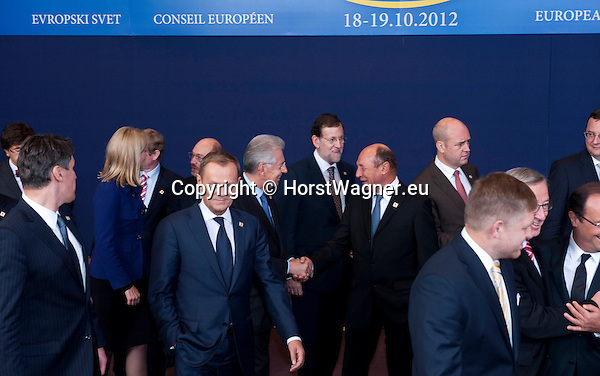 Brussels-Belgium - October 18, 2012 -- European Council, EU-summit meeting of Heads of State / Government; here, Mario MONTI (ce-le), Prime Minister of Italy, shakes hands with Traian BASESCU (ce-ri), President of Romania; after posing for the traditional family foto, i.a. Donald TUSK, Prime Minister of Poland; Mariano RAJOY BREY, Prime Minister of Spain; Fredrik REINFELDT, Prime Minister of Sweden  -- Photo: © HorstWagner.eu