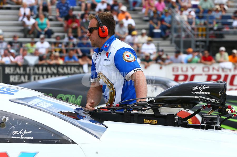 Jun. 2, 2013; Englishtown, NJ, USA: NHRA crew member for pro mod driver Mike Janis during the Summer Nationals at Raceway Park. Mandatory Credit: Mark J. Rebilas-