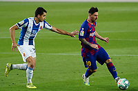 8th July 2020; Camp Nou, Barcelona, Catalonia, Spain; La Liga Football, Barcelona versus Espanyol; Leo Messi breals into the box, away from the challenge of Marc Roca of Espanyol