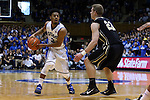 30 November 2014: Duke's Quinn Cook (2) and Army's Kyle Wilson (21). The Duke University Blue Devils hosted the West Point Military Academy Army Black Knights at Cameron Indoor Stadium in Durham, North Carolina in a 2014-16 NCAA Men's Basketball Division I game. Duke won the game 93-73.