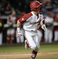 NWA Democrat-Gazette/ANDY SHUPE<br /> Arkansas shortstop Casey Martin watches as a solo home run leaves the ballpark against Western Illinois Tuesday, March 12, 2019, during the fifth inning at Baum-Walker Stadium in Fayetteville. Visit nwadg.com/photos to see more photographs from the game.