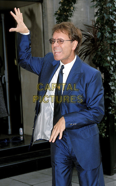 SIR CLIFF RICHARD..TRIC Awards ..Ref: 11537..funny, half length, half-length, blue pinstripes..www.capitalpictures.com..sales@capitalpictures.com..©Capital Pictures