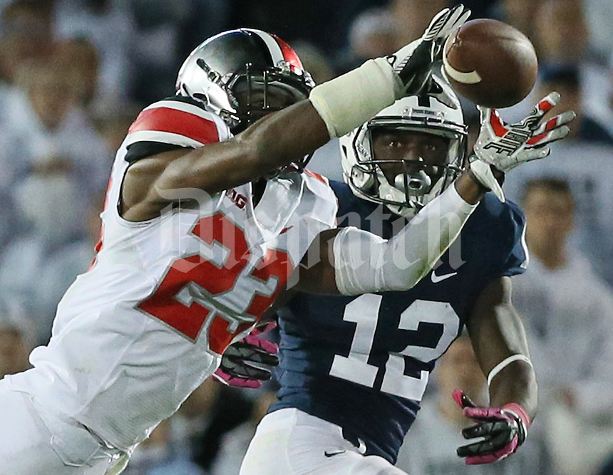 Ohio State Buckeyes safety Tyvis Powell (23) intercepts the ball from Penn State's Chris Godwin (12) in the fourth quarter of their game at Beaver Stadium in State College, PA on October 25, 2014. (Columbus Dispatch photo by Brooke LaValley)