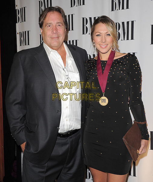 COLBIE CAILLAT (R) & father Ken .at The 2011 BMI Pop Music Awards held at The Beverly Wilshire Hotel in Beverly Hills, California, USA, May 17th 2011..half length  long sleeve dress black   gold studs  brown clutch bag medal family dad daughter .CAP/RKE/DVS.©DVS/RockinExposures/Capital Pictures.