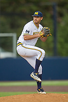Michigan Wolverines pitcher William Tribucher (22) delivers a pitch to the plate against the Oakland Golden Grizzlies on May 17, 2016 at Ray Fisher Stadium in Ann Arbor, Michigan. Oakland defeated Michigan 6-5 in 10 innings. (Andrew Woolley/Four Seam Images)