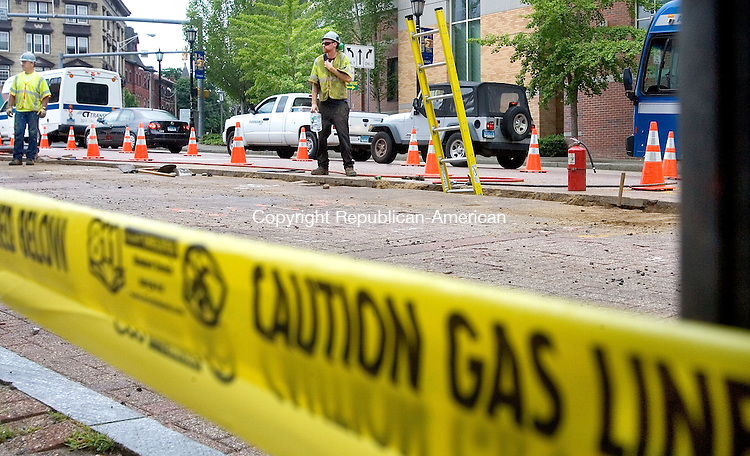 WATERBURY CT. 07 July 2015-070715SV03-A crew working for Eversource installs a gas line down East Main Street in Waterbury Tuesday. The construction will bring gas to the Green area. <br /> Steven Valenti Republican-American