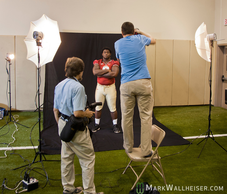 Photographers photograph sophomore Timmy Jernigan at FSU Media Day in Moore Athletic Center on the Florida State University campus  in Tallahassee, FL  August 12, 2012.