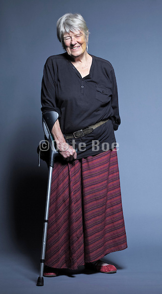 senior woman with crutch smiling