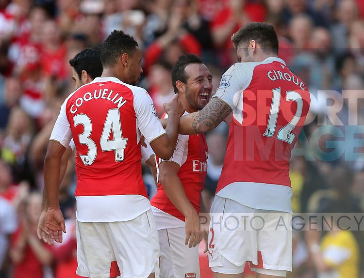 Arsenal's Olivier Giroud celebrates scoring his sides second goal with Santi Cazorla<br /> <br /> Barclays Premier League- Arsenal vs Stoke City - Emirates Stadium - England - 12th September 2015 - Picture David Klein/Sportimage