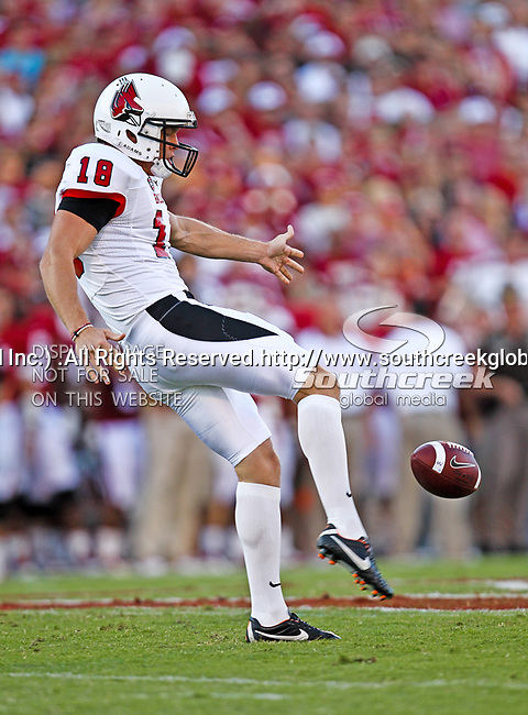 Ball State Cardinals punter Scott Kovanda (18) in action during the game between the Ball State Cardinals  and the Oklahoma Sooners at the Oklahoma Memorial Stadium in Norman, Oklahoma. OU defeats Ball State 62 to 6.