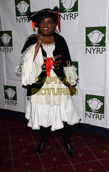GLORIA GAYNOR .Bette Midler's New York Restoration Project Annual Hulaween Gala held at the Waldorf-Astoria Hotel,New York, NY, USA, 30th October 2009..Halloween costume dressed-up full length white dress black cloak hat boots red ribbons .CAP/ADM/PZ.©Paul Zimmerman/Admedia/Capital Pictures