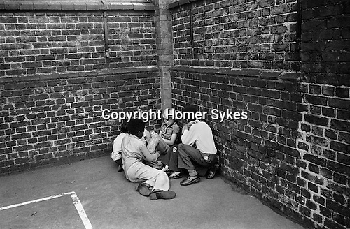 Primary school playground. Boys playing together. South London. 1970s Britain...