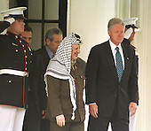 United States President Bill Clinton and walks Palestinian Authority Chairman Yasser Arafat from the West Wing of the White House after their talks in the Oval Office at the White House in Washington, DC on Thursday, June 15, 2000..Credit: Ron Sachs / CNP