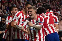 Hector Herrera of Atletico de Madrid celebrates after scoring with teammates during the Atletico de Madrid against Juventus Uefa Champions League football match at Wanda Metropolitano stadium in Madrid on September 18, 2019.