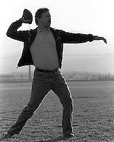 Dave Rifkin throws a football to his son, Devin Rifkin, at the San Ramon City Center Park, 1987.   &amp;#xA;<br />