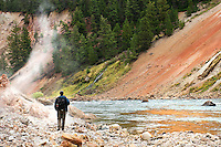 Matt Ludin, of Bozeman, Montana, explores the Grand Canyon of the Yellowstone at Sevenmile Hole in Yellowstone National Park.