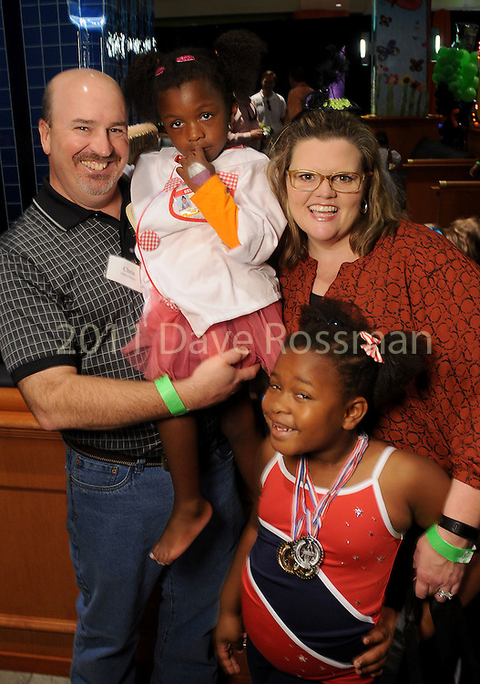 Stephanie and Chris Cheves with Serenity and Sophie at the Little Galleria Halloween Spooktacular presented by MD Anderson Children's Cancer Hospital at The Galleria Sunday Oct. 30,2016.(Dave Rossman photo)
