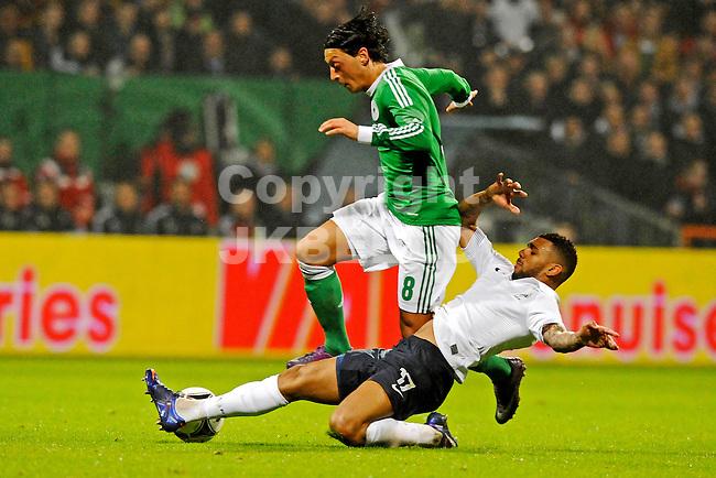 BREMEN - Voetbal, Duitsland - Frankrijk, vriendschappelijke interland, Weser stadion, 29-02-2012,  tackle van Yann' M Vila op Mesut Ozil