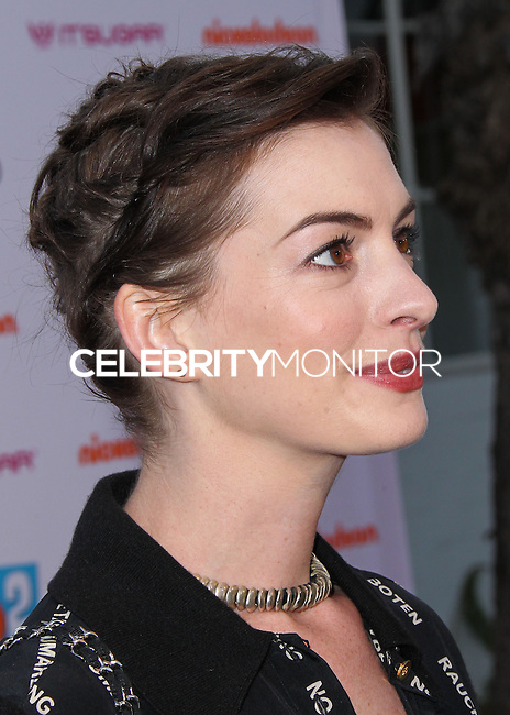 "BURBANK, CA, USA - APRIL 26: Anne Hathaway at the Lollipop Theater Network's Night Under The Stars Screening Of Twentieth Century Fox's ""Rio 2"" Hosted by Anne Hathaway held at Nickelodeon Animation Studios on April 26, 2014 in Burbank, California, United States. (Photo by Xavier Collin/Celebrity Monitor)"