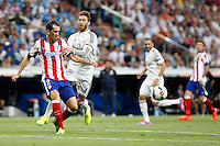 Sergio Ramos of Real Madrid and Godin of Atletico de Madrid during La Liga match between Real Madrid and Atletico de Madrid at Santiago Bernabeu stadium in Madrid, Spain. September 13, 2014. (ALTERPHOTOS/Caro Marin)