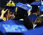 Jacob Grover, left,  gets his crown adjusted by Elena Boushee, Grover isn't exactly a  king but he is the class president who want on to give an amusing address to start the graduation ceremony, Wednesday evening, June 20, 2012, prior to the RHAM High School graduation ceremony at the school in Hebron. (Jim Michaud/Journal Inquirer).