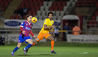 Jodi Jones of Dagenham & redbridge controls the ball under pressure from Sido Jombati of Wycombe Wanderers during the Sky Bet League 2 match between Dagenham and Redbridge and Wycombe Wanderers at the London Borough of Barking and Dagenham Stadium, London, England on 9 February 2016. Photo by Andy Rowland.