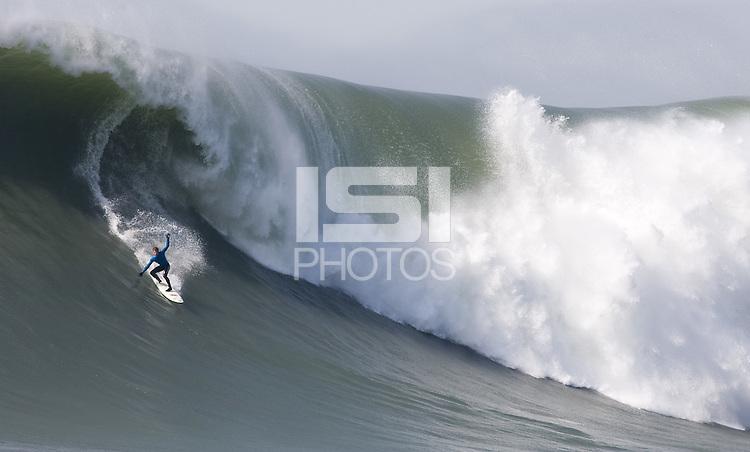 Carlos Burle competes in the 2010 Mavericks Surf Contest, Saturday, Feb. 13, 2010, Half Moon Bay, California.