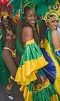 Germany, DEU, Dortmund, 2006-Jun-22: FIFA football world cup (USA: soccer world cup) 2006 in Germany; a Brazilian samba group dancing in the street, watched by football fans on their way to the world cup stadium.