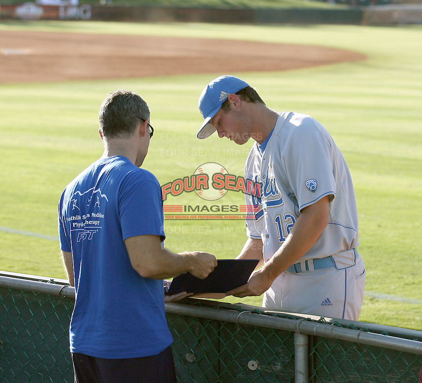 Gerrit Cole #12 of the UCLA Bruins signs an autograph for a fan before a against the Arizona State University Sun Devils at Packard Stadium on May 28, 2011 in Tempe, Arizona. .Photo by:  Bill Mitchell/Four Seam Images.