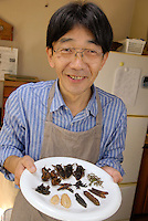 "Shoichi Uchiyama holding a plate of insect ingredients ready for cooking. Tokyo resident Shoichi Uchiyama is the author of ""Fun Insect Cooking"". His blog on the topic gets 400 hits a day. He believes insects could one day be the solution to food shortages, and that rearing bugs at home could dispel food safety worries."