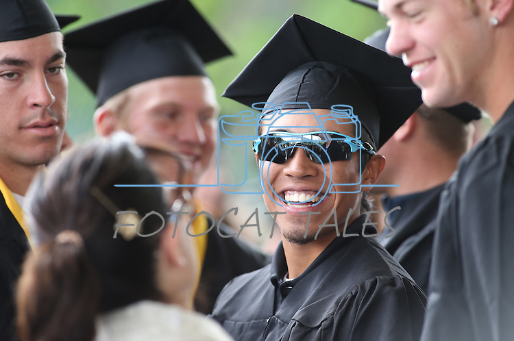 Tony Roque talks with friends before the Western Nevada College commencement at the Pony Express Pavilion, in Carson City, Nev., on Monday, May 19, 2014. A record-high 543 students graduate from WNC this week. <br /> Photo by Cathleen Allison/Nevada Photo Source
