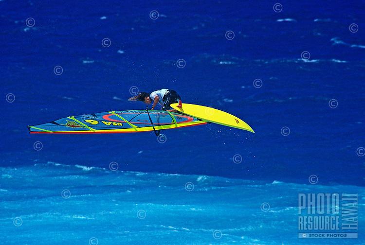 An airborne windsurfer at world famous Hookipa Beach Park, Maui