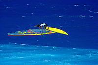 An airborne windsurfer at world famous Hookipa Beach Park, Maui